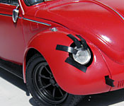 Ninja Cheerleaders Volkswagen Beetle damaged headlight detail